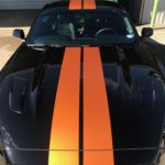 Longhorn Orange race stripes added to black Mustang GT
